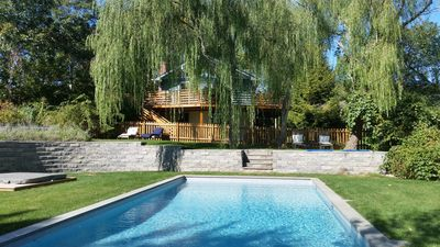 Private outdoor oasis with heated pool and hot tub.