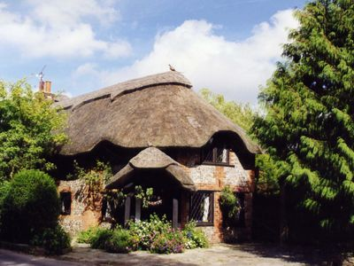 Photo for 15th Century Thatched Cottage 10 miles from Historic Portsmouth