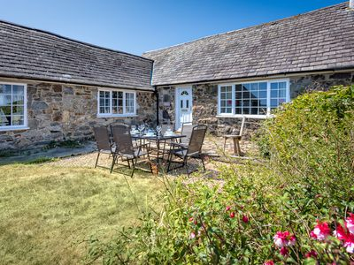 Photo for With excellent walking from the door to a choice of beaches, this pretty cottage boasts fantastic vi