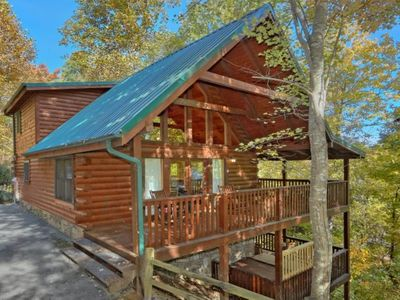 "Photo for A Genuine Log Cabin, ""Gray Fox Den"" features a home theater and convenience."