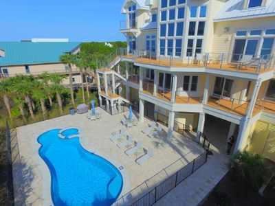 Gulf side of home, view of pool and board walk that leads to the beach!