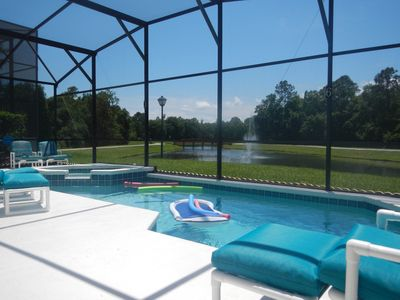 Photo for 5 bed Disney villa south facing pool and spa. Lake view. Gated community. Wi-fi