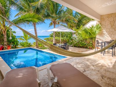 Stunning beachfront condo with a private pool - AC, Wifi, Kayaks