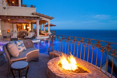 Outdoor Pool Terrace - In the evening, the fire bowl in the sitting area, combined with the infinity pool, spa, and the Sea of Cortez stretching for miles, creates an enchanting fire-and-water effect that is like nothing you've seen before.