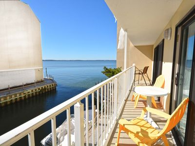 Photo for Luxury 2 bedroom bayfront condo with free WiFi, an outdoor pool, and beautiful decor located midtown and just two blocks from the beach!