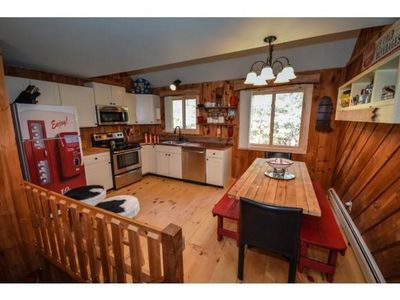 Kitchen w/ handmade table and copper countertops