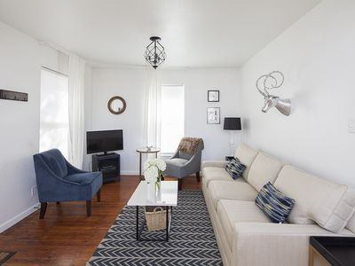 Living room with comfy Ethan Allen Sofa and digital TV with free on-demand