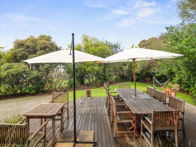 Photo for A Beautiful appointed house with lush private gardens setting in a quiet court.