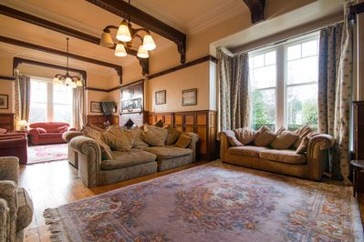 The sitting room has two seating areas