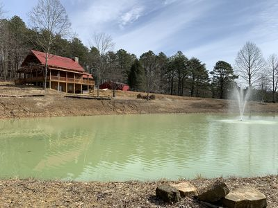 Photo for Hilltop log cabin with beautiful fishing pond, stunning views, & nature trails