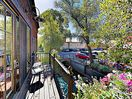 Balcony - This charming rental sits above a bakery and is nestled on a creek in downtown.