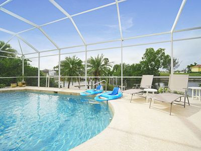 Photo for Inviting and sunny,  gulf access, pool home! Freshly updated!