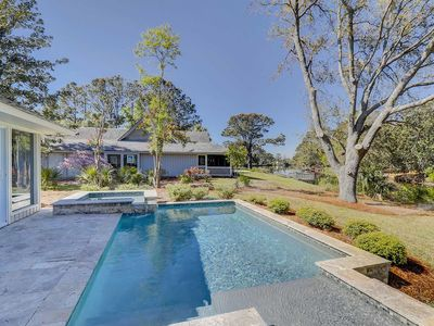 Photo for Stunningly remodeled house with a private pool & spacious floor plan