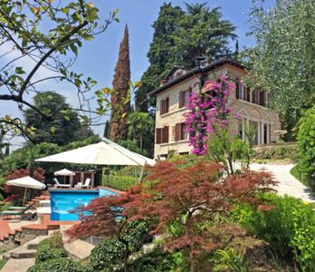Photo for Holiday in the fairytale castle - Luxury villa directly on the lake with large pool