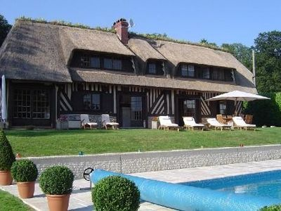 Photo for Superb Villa with pool, near Deauville former cider mill