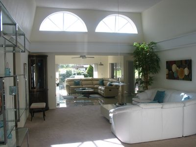 Large bright living rooms with 2 skylights overlooking golf course