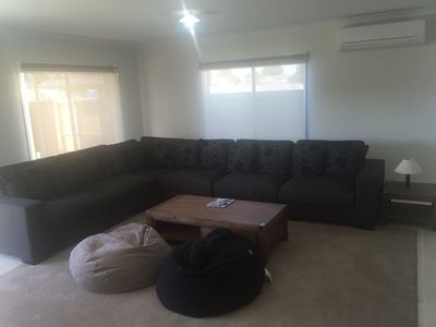 Lounge Room - The comfy couch easily sits 8