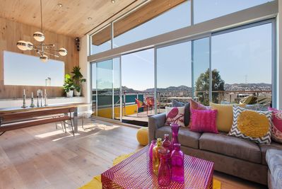 Living and dining combined in open floor plan with view of Sutro Tower