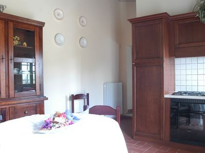 Photo for Apartment The Walnut Farmhouse with swimming pool on the hills of Pisa