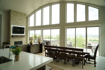 Awesome TV viewing great room with a big table and amazing views and deck.