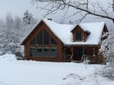 Cozy Family-friendly Log Cabin With 25ft Interior Fireplace + Modern Amenities.