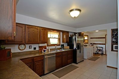 Large kitchen with stainless appliances. Washer and dryer included