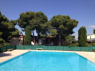 Photo for Nice apartment in a quiet area, magnificent view of the golf course, swimming pool and tennis