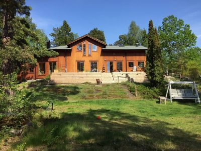 Photo for Wonderful familyfriendly wooden house at a lake in Stockholm countryside