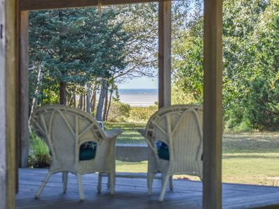 Photo for #519: Private beach access, Screened in dining, Wrap around porch! Dog friendly!