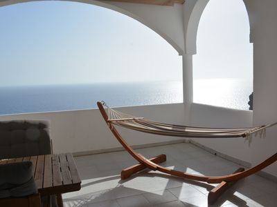 Photo for Stunning sunsets from large, private balcony 8 mins walk to beaches