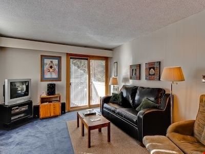 Relax in the cozy living area, complete with comfortable sofas
