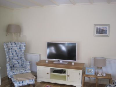 Living room with comfortable seating for 6, woodburner, tv, dvd, cd iphone dock.