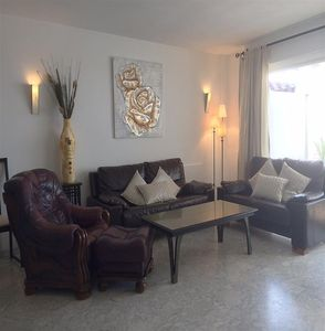 Modern and bright lounge with comfortable seatings and access to the terrace