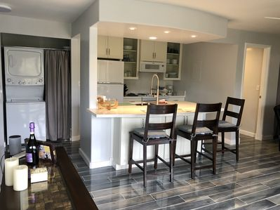 Dining area/kitchen, open floor plan, washer & dryer, laundry soap provided