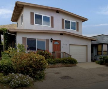 Photo for Fantastic sunsets and ocean views on Studio Drive, west of Hwy 1. Steps to beach