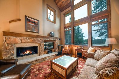 The grand living room features a flat screen TV as well as a gas fireplace