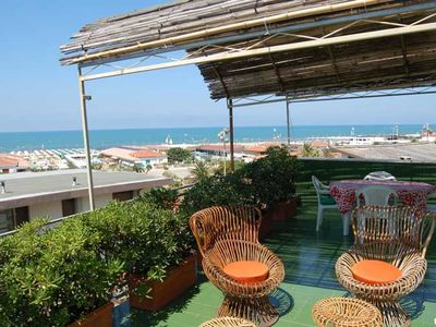 Photo for Nice apartment with large terrace w/ fantastic view of the sea