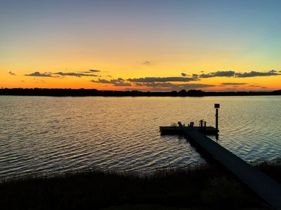 Photo for Waterfront Bay Bungalow,private pier,stunning sunrises and sunsets.