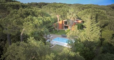 Photo for Architect's villa with swimming pool, jacuzzi in a park of greenery.