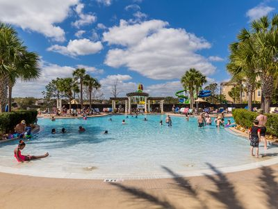 Photo for Remodeled condo in resort, 5 min to Disney. WiFi, water slides, pool, arcade!