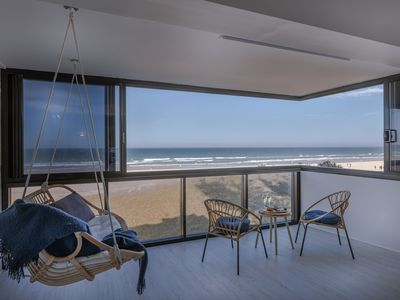 Photo for Tastefully renovated Beachfront apartment with retro feel & private beach access
