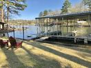 View from yard of dock and cove off main channel of Lake Hamilton.