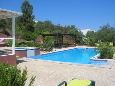 Fazendinha Guest House pool and double BBQ area near Tavira