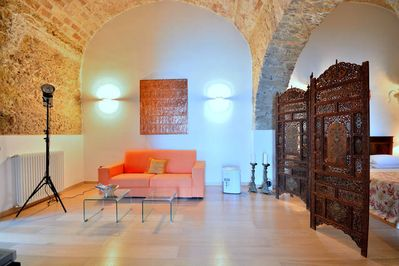 living area, divided by paravent from sleeping area, stone vaulted ceiling