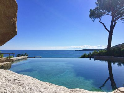 Photo for Seafront property with infinity pool near the beach in the best location of Elba