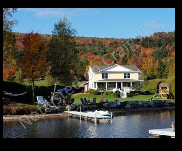 """WOW!!! Must Read """"Reviews"""" on this 4-5 BR. 2 BA. w/Game Rm Lake Front Home"""
