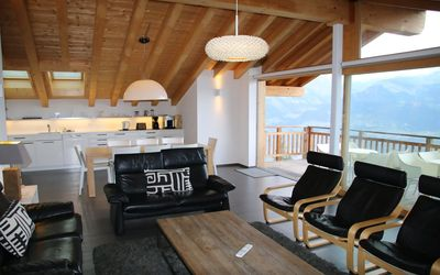 Photo for 5* luxury 4-Bedroom-Apartment for 8 people located next to the ski lift. Modern living room with fir
