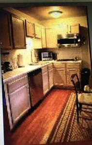 Fully equipped kitchen with pots and pans, all dishes cooking/eating utensils
