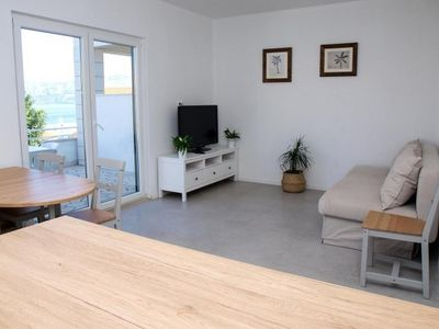 Photo for Two bedroom apartment with terrace and sea view Postira, Brač (A-17323-d)