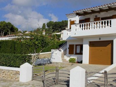 Photo for A menorcan style semi-detached villa, without pool, located on the main street of Son Bou. The house